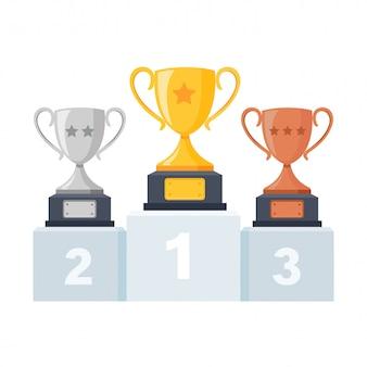 Goud, zilver, bronzen trofee beker, beker op podium, voetstuk geïsoleerd op wit. 1e, 2e, 3e plaats.