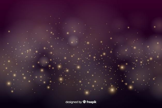 Gouden achtergrond met gouden deeltjes