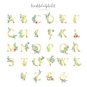 Gouden alfabet collectie met florale ornamenten
