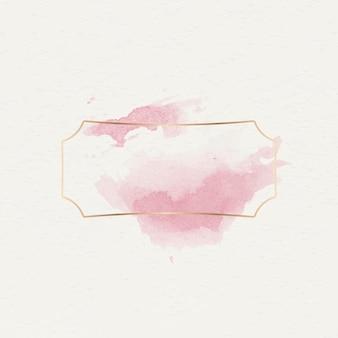 Gouden badge met roze aquarelverf