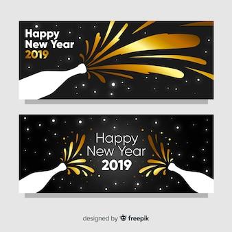 Gouden champagne nieuwe jaarachtergrond