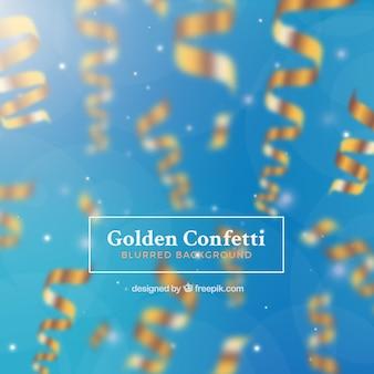 Gouden confetti met onscherpe achtergrond