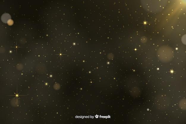 Gouden deeltjes bokeh achtergrond