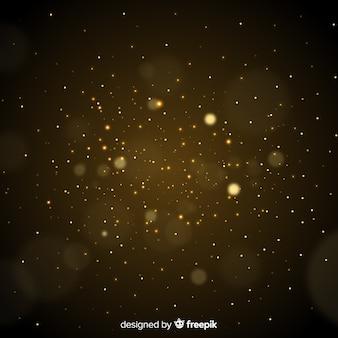 Gouden deeltjes wazig decoratieve achtergrond