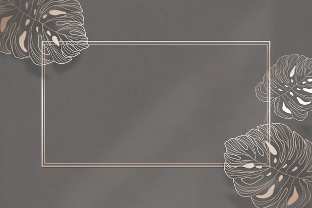 Gouden frame met monstera blad patroon achtergrond