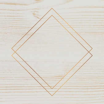 Gouden frame op beige houten achtergrond