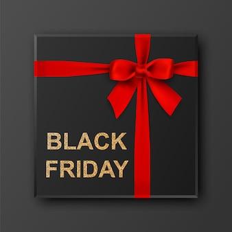 Gouden glitter textuur op zwarte geschenkdoos