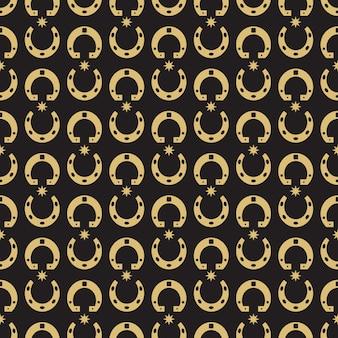 Gouden hoefijzer en sterren naadloos patroon