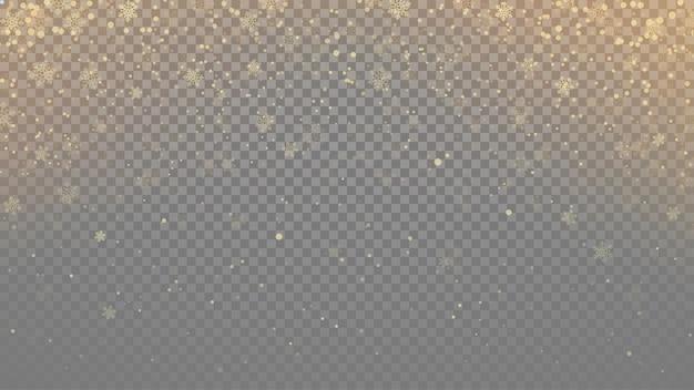 Gouden kleur transparante sneeuwvlokken bij sneeuwval met licht glanzend effect
