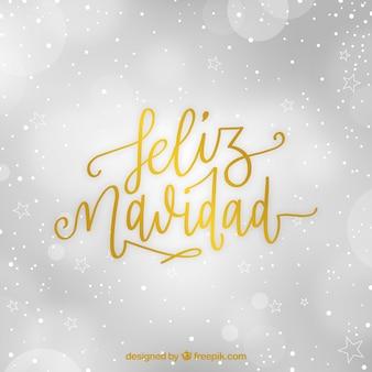 Gouden letters van vrolijk kerstfeest met bokeh achtergrond