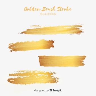Gouden penseelstreek ingesteld Gratis Vector