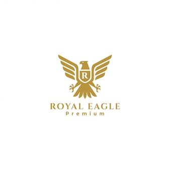 Gouden royal eagle-badge-logo, valk-logo, havik-logo, heraldisch eagle-logo Premium Vector