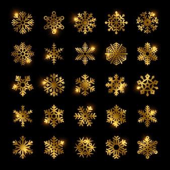 Gouden sneeuwvlokken set geïsoleerd op zwart