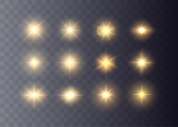Gouden sterren en vonken geïsoleerde vector fakkels en zonnestralen gloeiende lichteffecten collectie