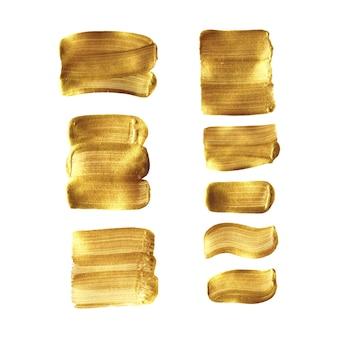 Gouden verf penseelstreek uitstrijkje set geïsoleerd