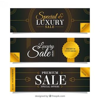 Gouden verkoop banners met lijnen