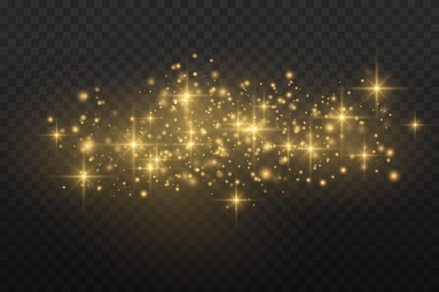 Gouden vonken en gouden sterren glitter speciaal lichteffect. schittert op transparante achtergrond. kerst abstract. stof.