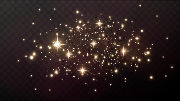 Gouden vonken en gouden sterren schitteren met een echt lichteffect. de explosie van de gouden confetti.