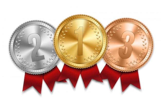 Gouden, zilveren en bronzen medaille met lint set.