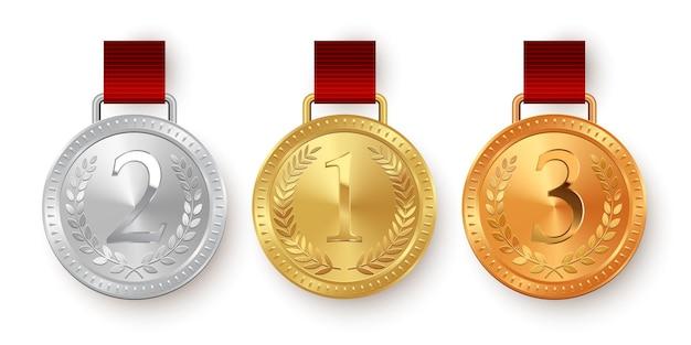 Gouden zilveren en bronzen medailles met rode linten die op witte achtergrond worden geïsoleerd