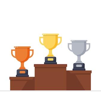 Gouden, zilveren en bronzen trofee op het podium van de winnaar