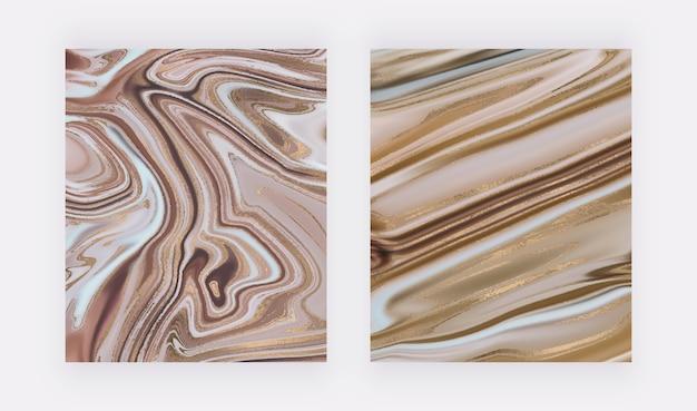 Goudfolie vloeibare inkt ontwerp achtergronden met golf glitter splatter textuur.