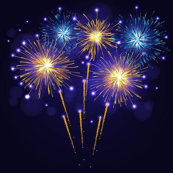 Goudgeel blauw vuurwerk over nachtelijke hemel.