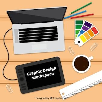 Grafisch ontwerp werkruimteachtergrond met bureau en hulpmiddelen
