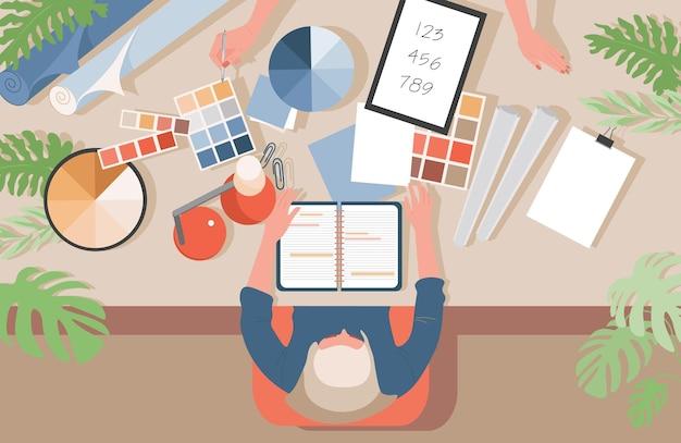 Grafisch ontwerper op het werk vector platte illustratie ontwerper op de werkplek