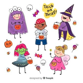 Grappig en schattig halloween kostuum kinderen ingesteld met snoep