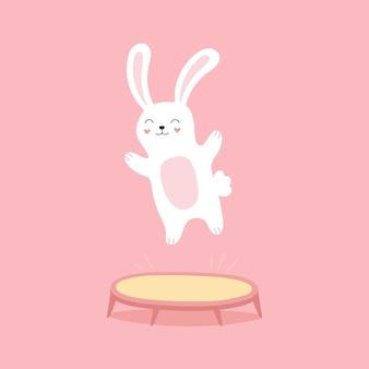 Grappig konijntje dat op een trampoline springt. blij stripfiguur voor kinderen.