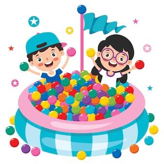 Grappige jongen spelen met kleurrijke ballen