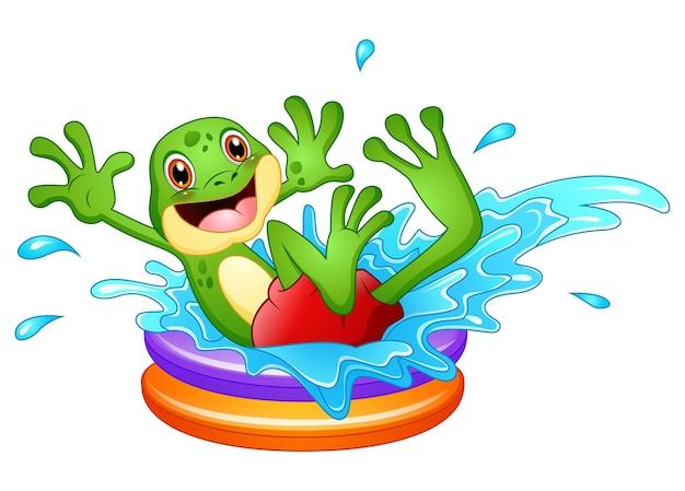 Grappige kikker cartoon zit boven opblaasbaar zwembad