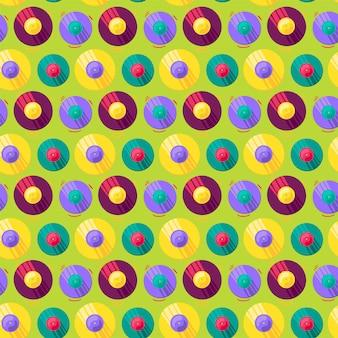 Grappige kleurrijke muzikale vinyl record vector patroon. vintage naadloze design flyer en poster voor evenement of nachtclub op groene achtergrond. moderne creatieve schets om af te drukken. platte cartoon illustratie