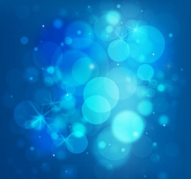 Gratis glinsterende blauwe lichten vector achtergrond
