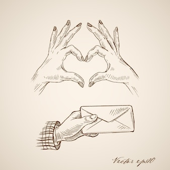 Gravure van vintage hand getrokken vrouwelijke handen hartsymbool en mannenhand envelop maken