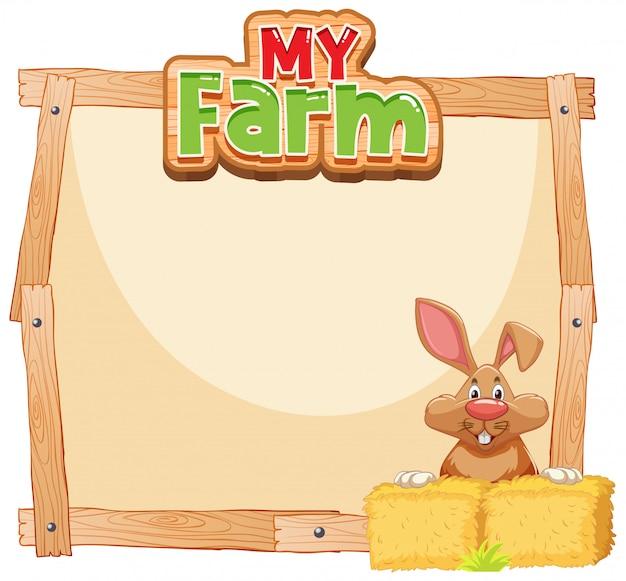Grens sjabloonontwerp met bruin konijntje en hooi