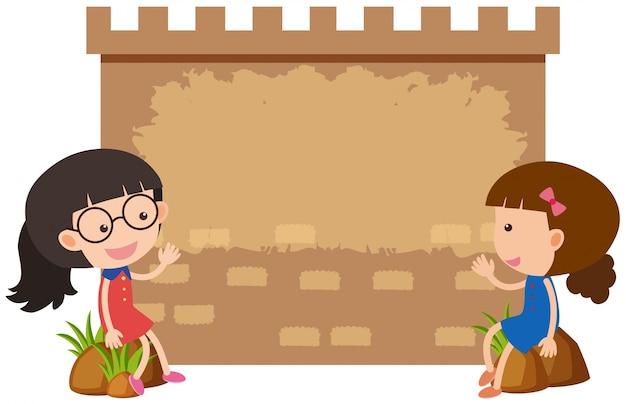 Grensmalplaatje met twee meisjes op rotsen