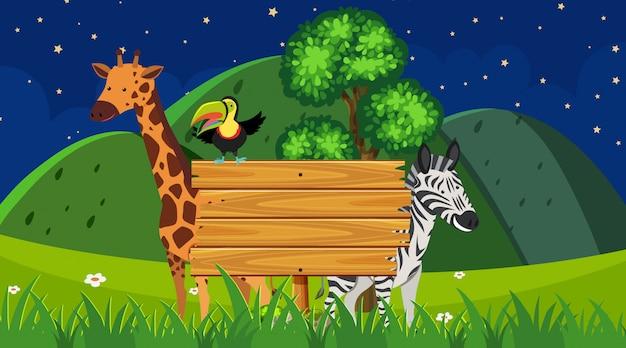 Grensmalplaatje met wilde dieren op de parkachtergrond