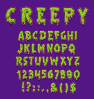 Griezelig halloween-lettertype van groen slijmtype met hoofdletters en cijfers of cijfers.