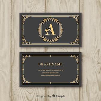 Grijs visitekaartje met gouden tekst