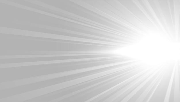 Grijze achtergrond met wit gloeiend stralenontwerp