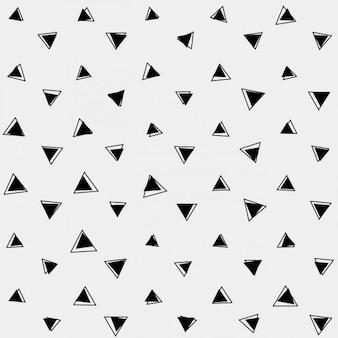 Grijze achtergrond met zwarte driehoeken