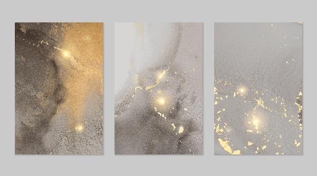Grijze en gouden marmeren abstracte texturen