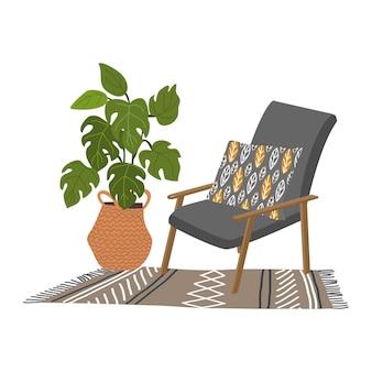 Grijze fauteuil en een decoratief kussen, een gebreid tapijt en monstera in een rieten mand