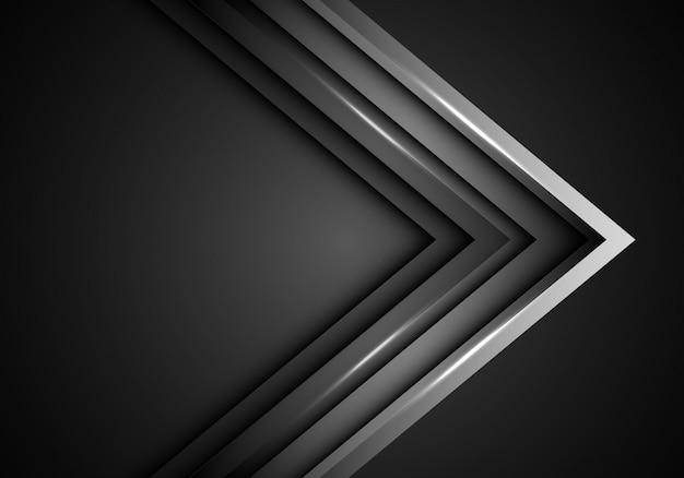 Grijze metalen pijlrichting op donkere lege ruimte achtergrond.