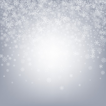 Grijze sneeuwachtergrond. sneeuwvlok.