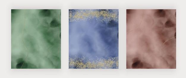 Groen blauwe en rode penseelstreek aquarel textuur met gouden glitter lijnen