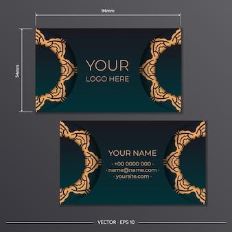 Groen visitekaartjeontwerp met vintage patronen. stijlvolle visitekaartjes met luxe ornamenten.