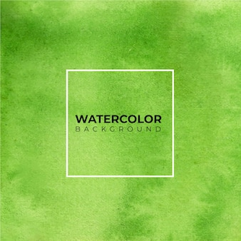 Groene abstracte aquarel handverf. kleur spatten op het witte papier